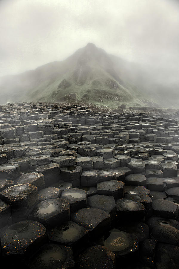 Giant Causeway Photograph - Hexagon Stones And A Mountain In The Morning Fog by Jaroslaw Blaminsky