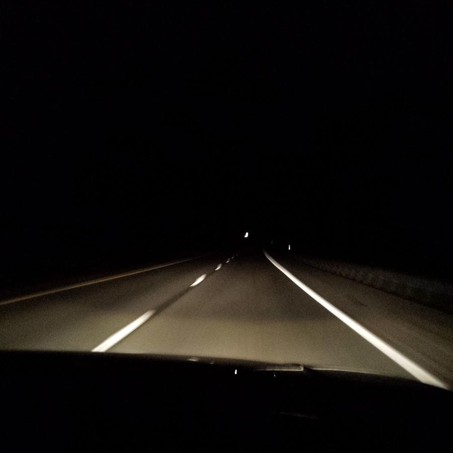 Highway at Night Photograph by Nicole Borzotra