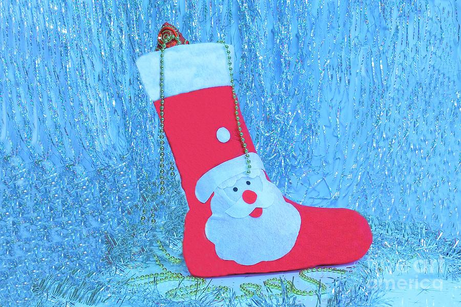 Holidays Symbol Stocking. Red Christmas Sock With Gifts On A Light Background. Christmas Background. Photograph