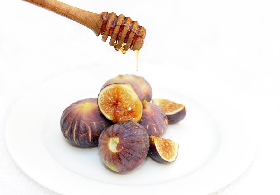 Honey dripping on figs by Paul Cowan