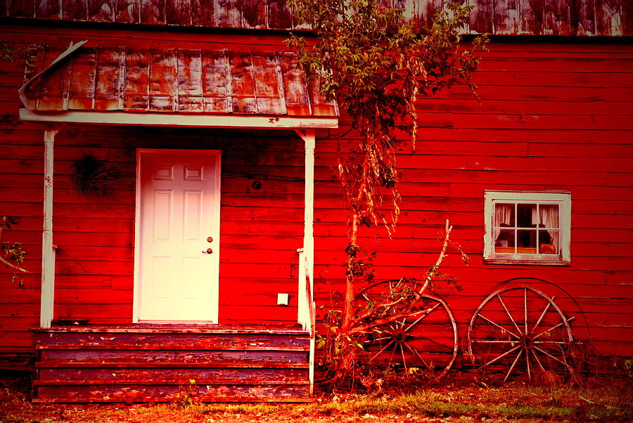 Wagon Wheel Photograph - House Of The Wagon Wheels by Emily Stauring