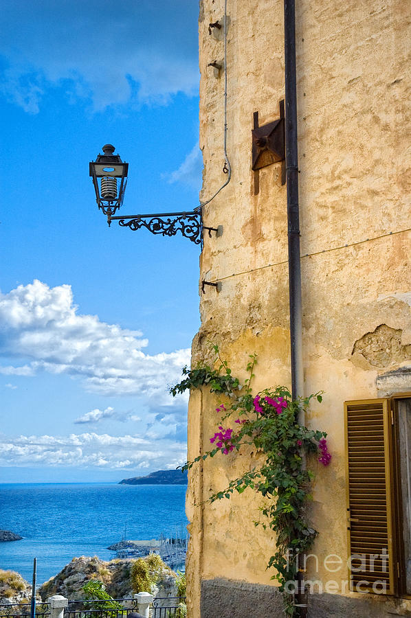 Architecture Photograph - House With Bougainvillea Street Lamp And Distant Sea by Silvia Ganora