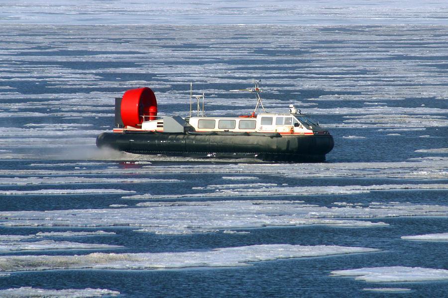 Arctic Ocean Photograph - Hovercraft On Frozen Artic Ocean by Anthony Jones