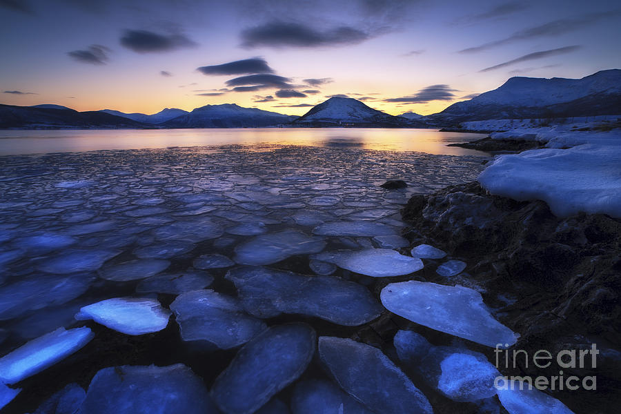 Ocean Photograph - Ice Flakes Drifting Against The Sunset by Arild Heitmann