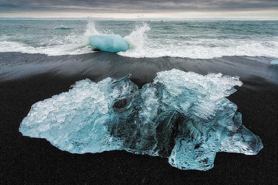 Iceberg and black beach in Iceland by Matthias Hauser