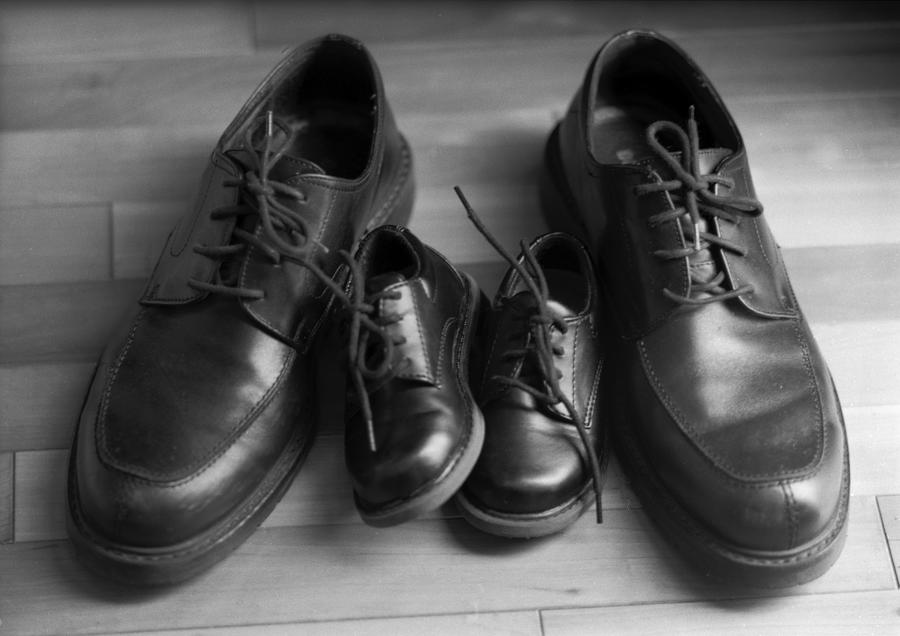Black And White Photograph - In Their Shoes by Ayesha  Lakes