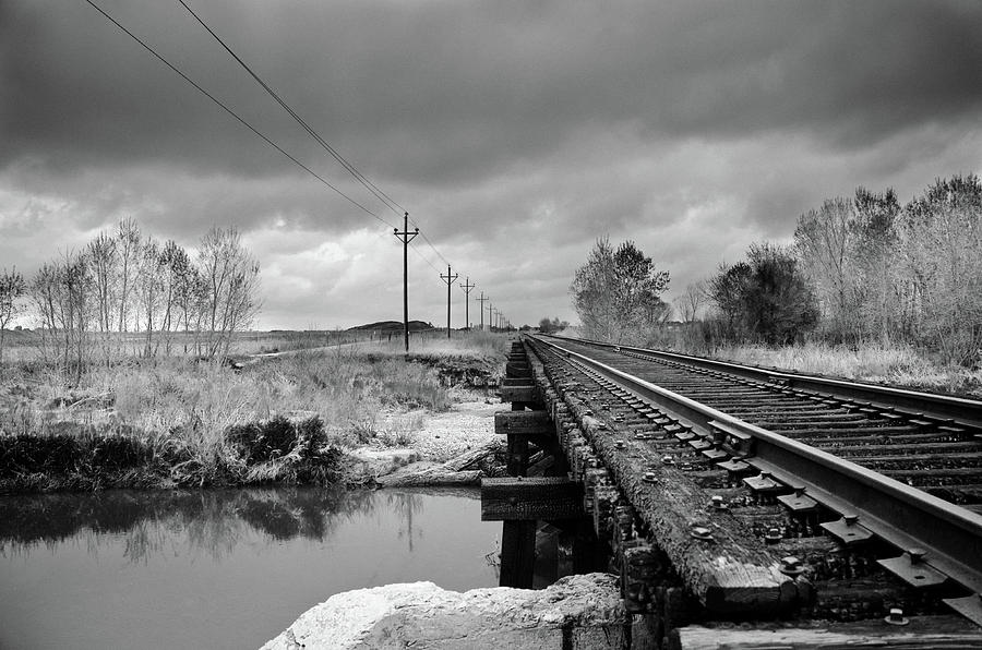 Railroad Tracks Photograph - Into The Distance by Matthew Angelo
