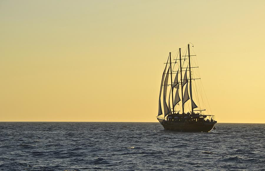 Sail Photograph - Into The Sunset by Corinne Rhode