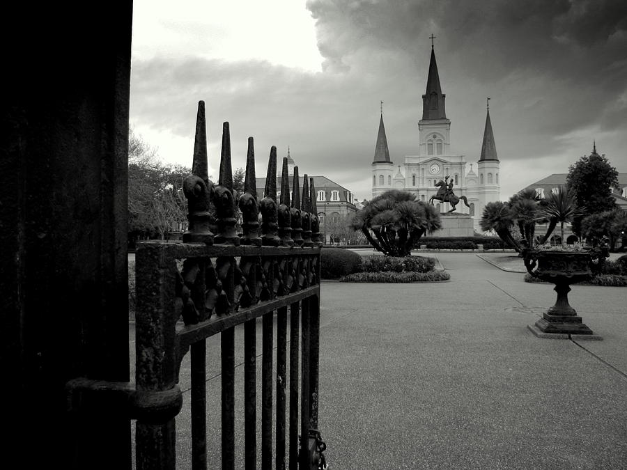 New Orleans Photograph - Jackson Square Gate With St. Louis Cathedral And Storm Clouds by Toni and Rene Maggio