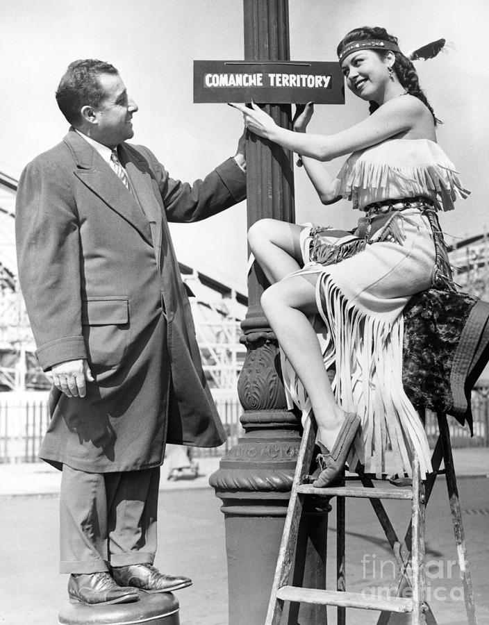 Jeanna Carmen Puts Sign On Post With Thomas H. Tesaurao. Photograph by Barney Stein