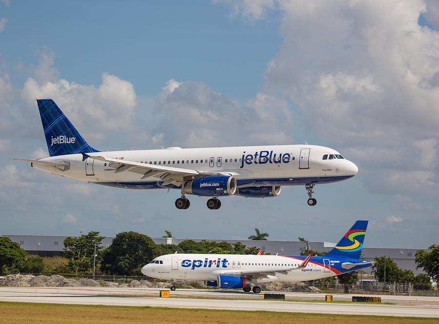 JetBlue over Spirit Air Photograph by Dart and Suze Humeston