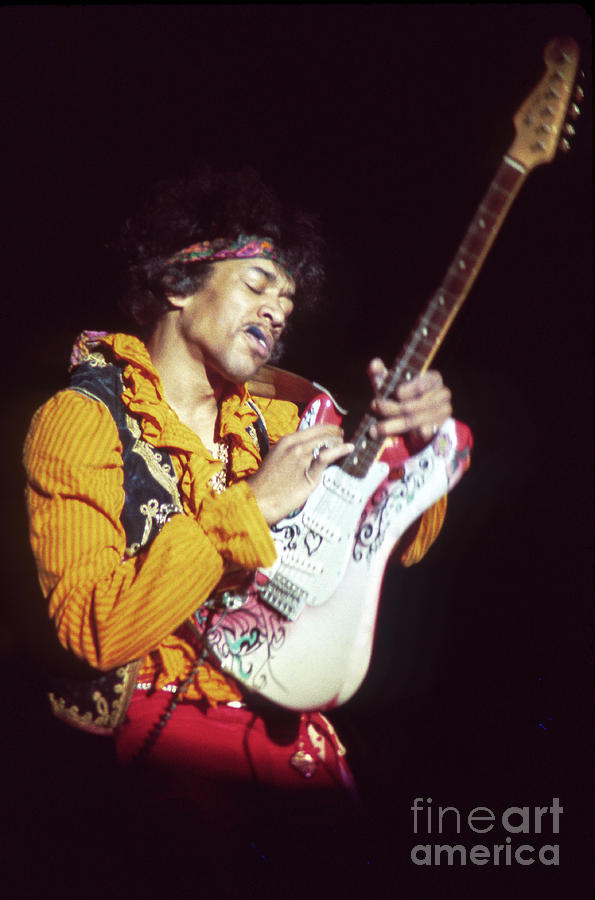 Color Photograph - Jimi Hendrix Performing With Pick In Mouth Monterey Pop Festival Fine Art Print by Jill Gibson