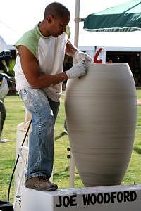 Joeseph Woodford At Work During The Celebration Ceramic Art by Joseph Woodford