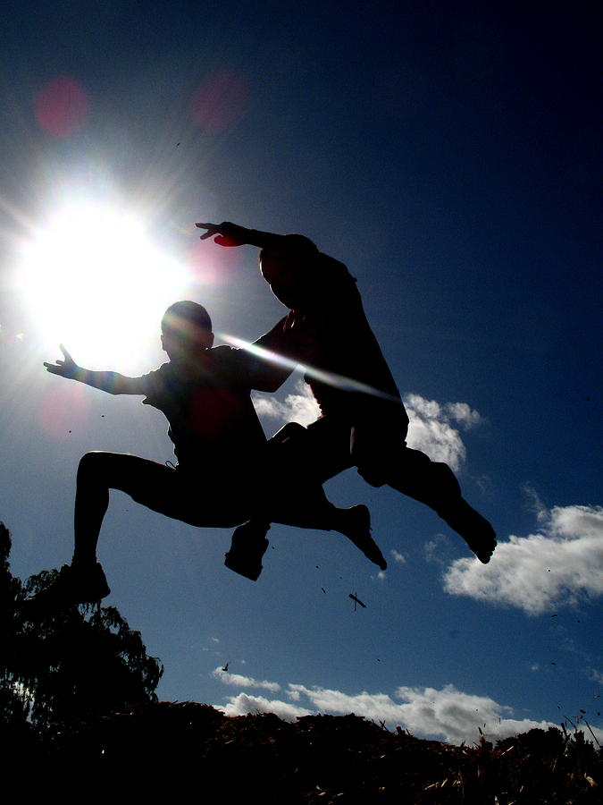 Kids Photograph - Jumping Into The Light by Nico Smith