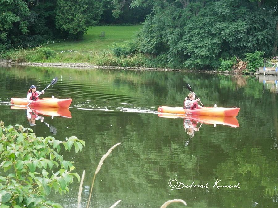 Kayaks on the River by Deborah Kunesh