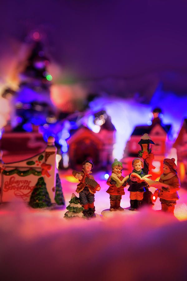Colorful Christmas.Kid Choir Singing Next To Seasons Greeting Sign With Colorful Christmas Village In The Background H