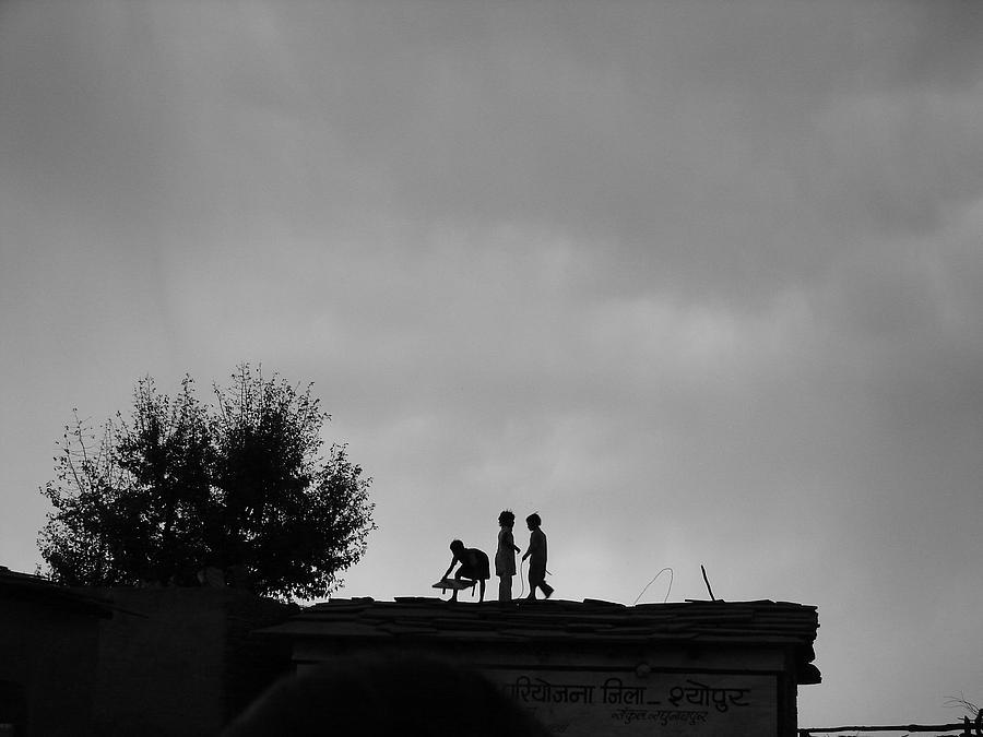 Kids Are Taking Care Of Thier Solar Panels As Sun S Setting Photograph by Sandeep Khanwalkar