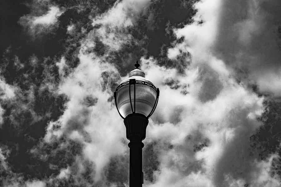 B&w Photograph - Lamp In The Clouds by Eddie Mathis