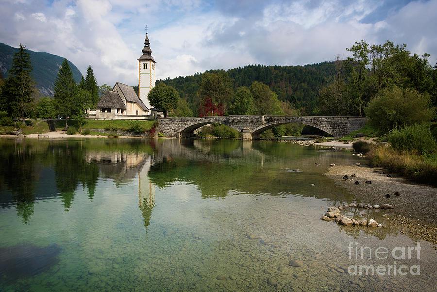 Bohinj Photograph - Lake Bohinj with church in Slovenia by IPics Photography