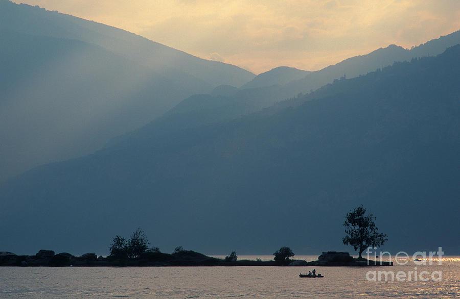 Lake Garda Photograph - Lake Garda Dusk With Fisherman by Damian Davies