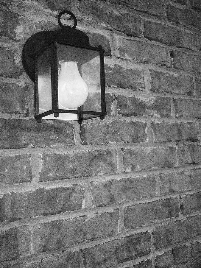 Light Photograph - Lantern On Brick Wall  by Nicole Aponte