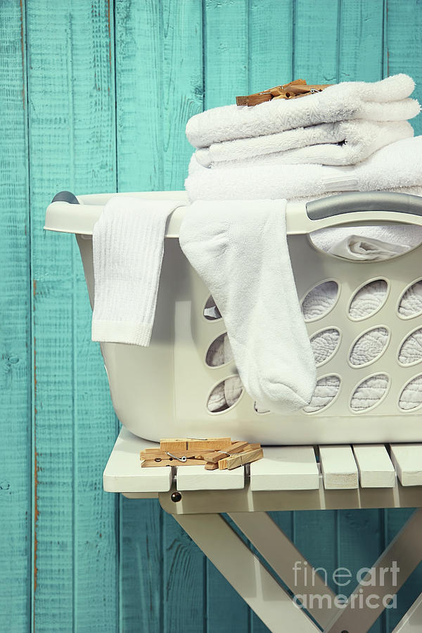 Laundry basket with towels by Sandra Cunningham