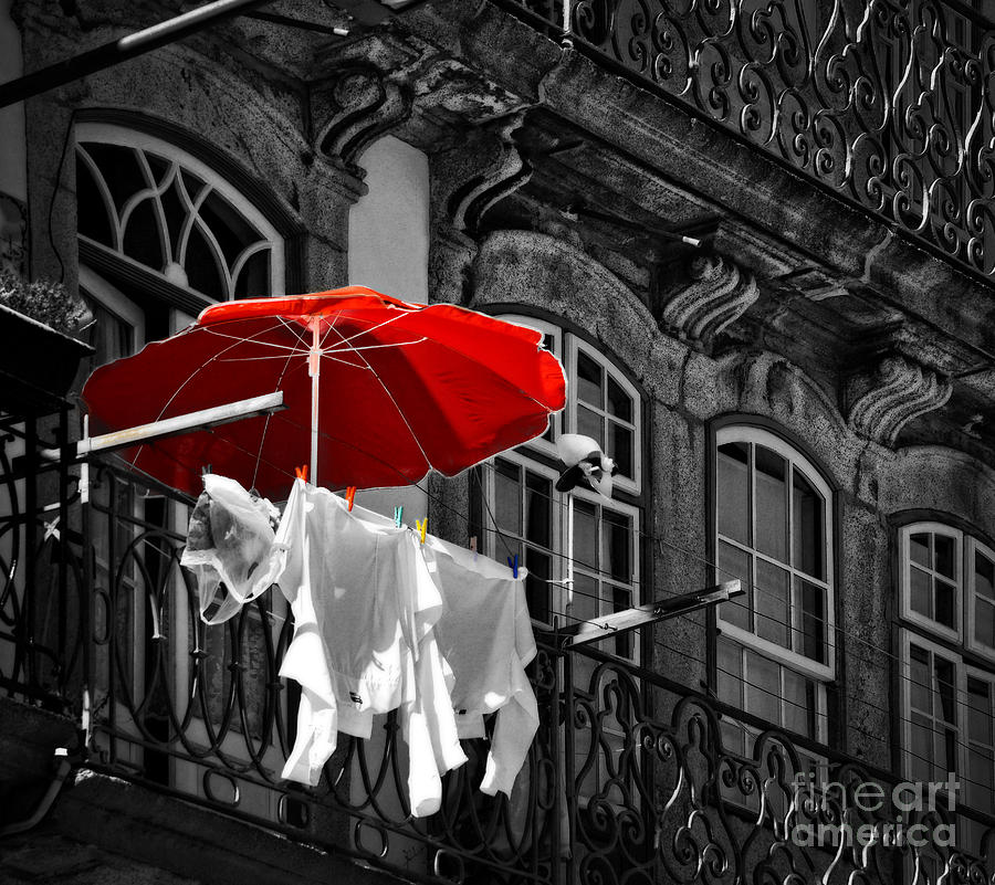 Laundry photograph laundry with red umbrella in porto portugal by mary machare