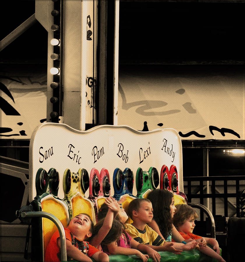 Carnival Rides Photograph - Leapfrog by Colleen Kammerer