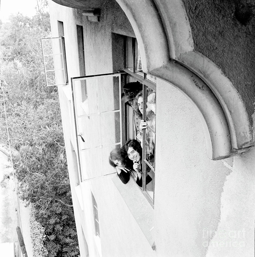 Led Zeppelin Looking Up From A Window At Chateau