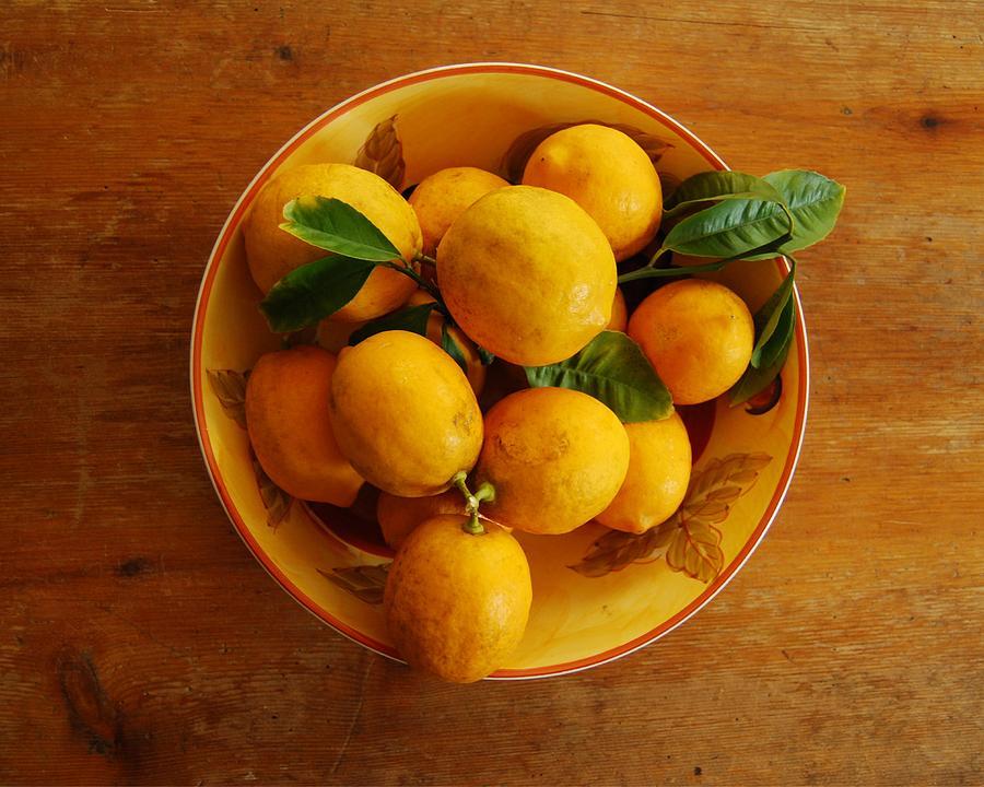 Lemons in bowl by Jocelyn Friis