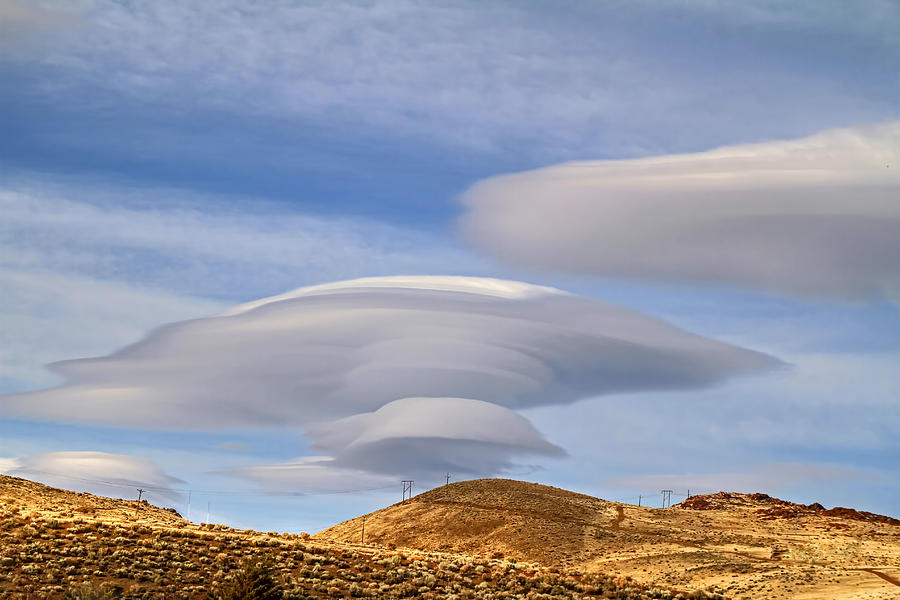 Lenticular Clouds Photograph - Lenticular Landing by Donna Kennedy