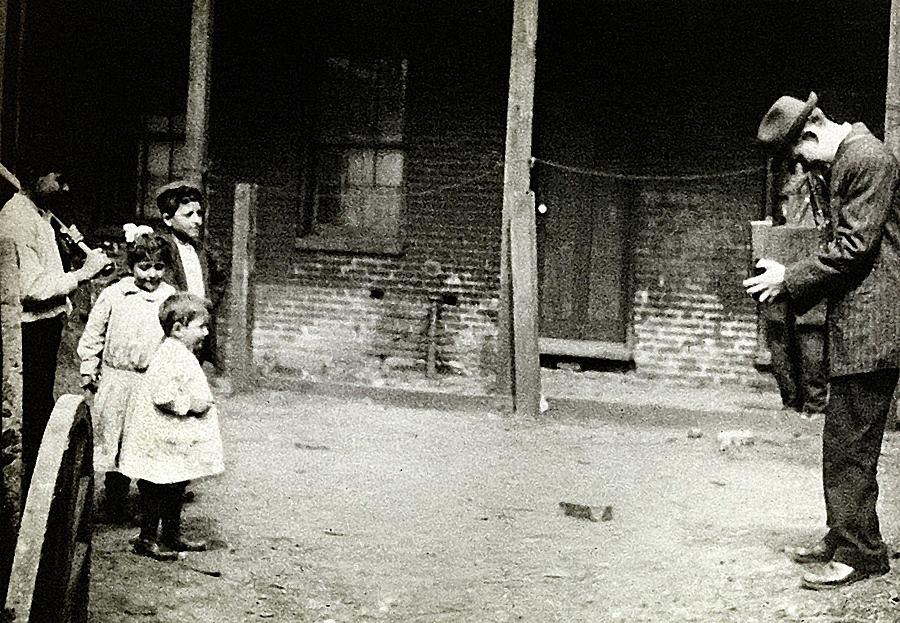 Lewis Hine photographing children in a slum location or photographer unknown circa 1910 by David Lee Guss