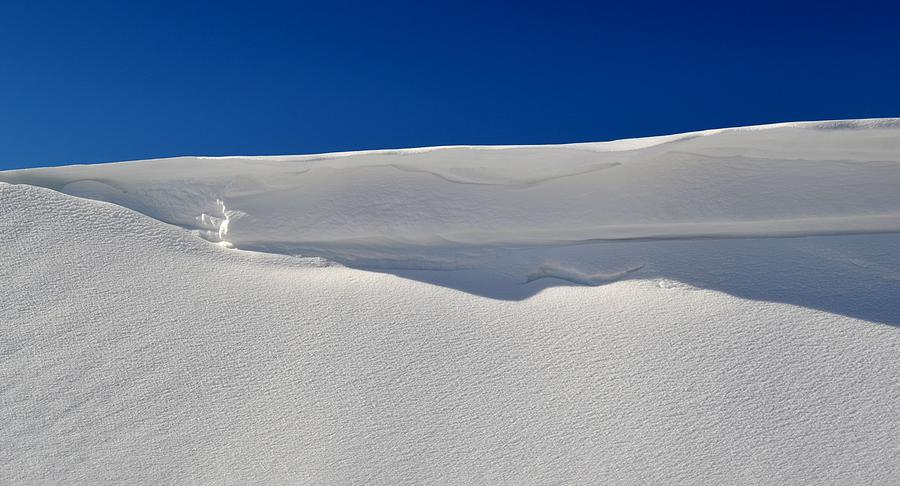 Abstract Photograph - Light And Shadow On The Snow  by Lyle Crump