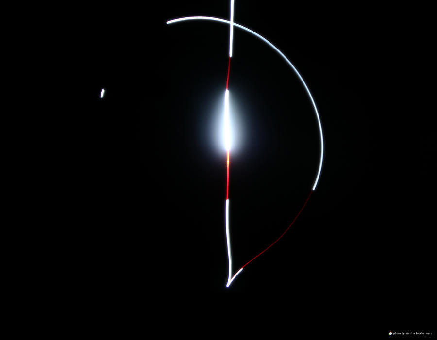 Light Painting Photograph - Light Eclipse by Nicolas Lockheimers