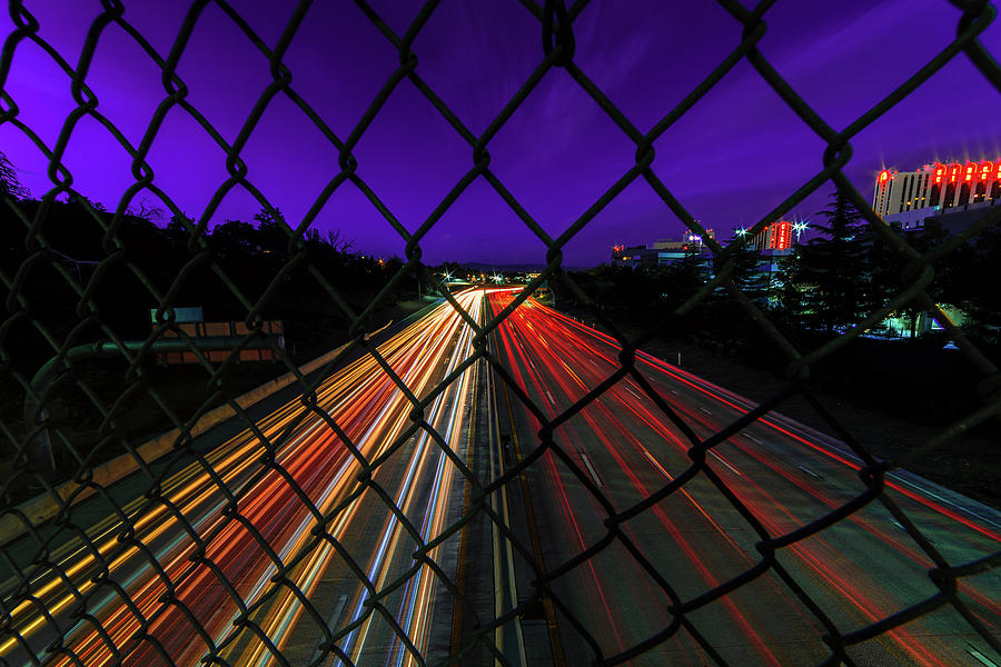 Light Trails Of Vehicles On I-80 On A Summer Night In Downtown Reno Under A Purple Sky Photograph