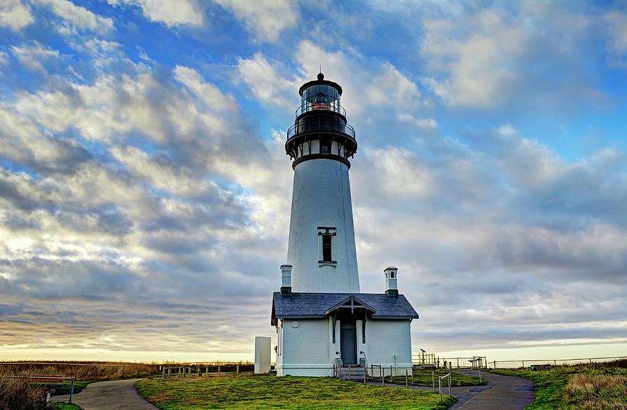 Lighthouse And Clouds by Marv Vandehey
