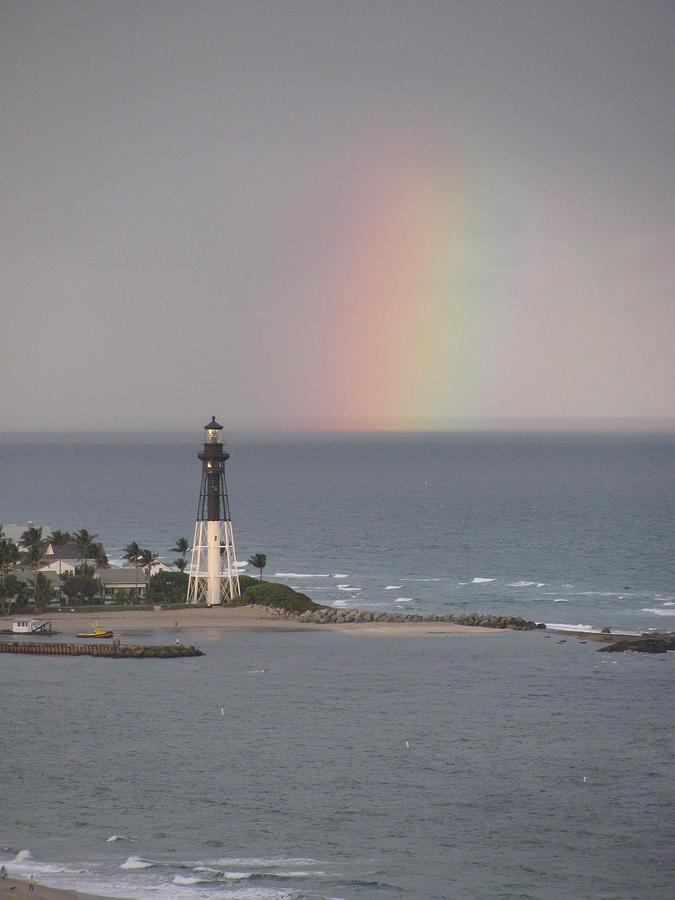 Lighthouse Photograph - Lighthouse and Rainbow by Corinne Carroll