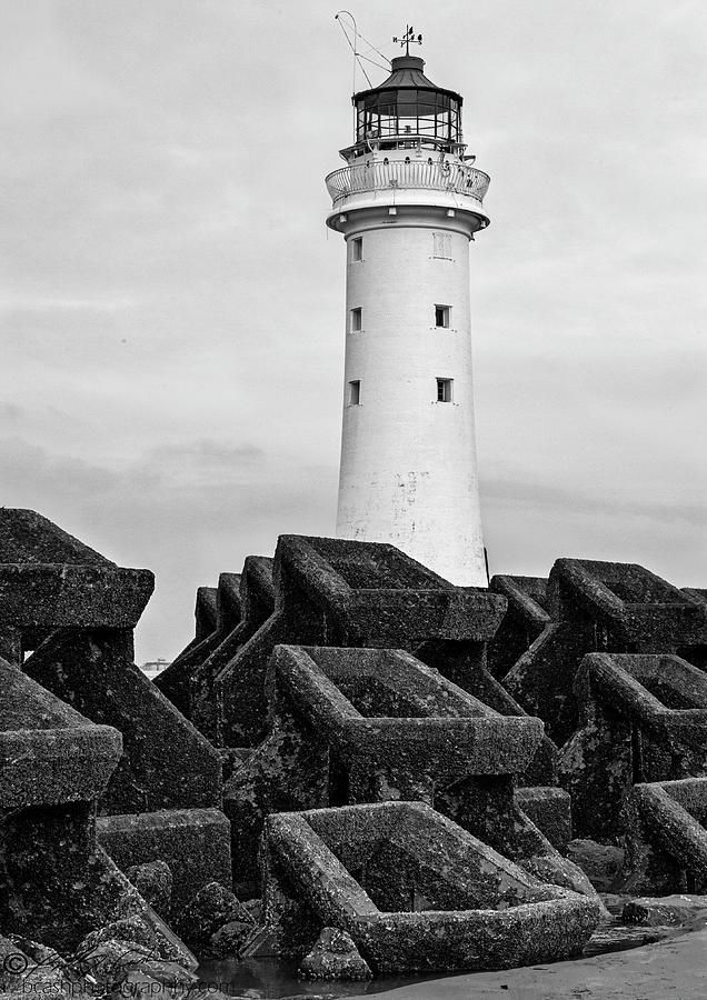 Lighthouse And Sea Wall Photograph