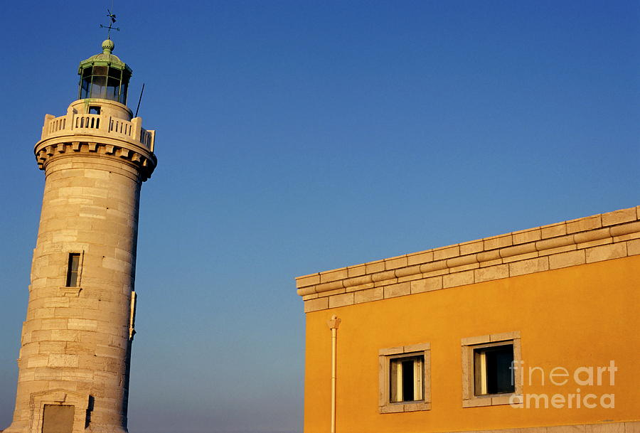 Architectural Photograph - Lighthouse And Yellow Building At The Entrance Of The Port Of Marseille by Sami Sarkis