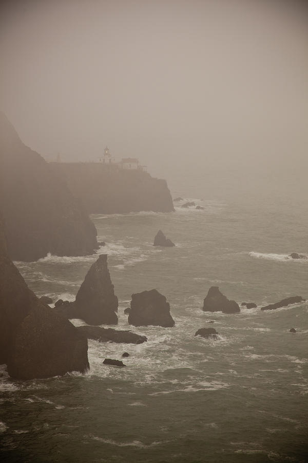 Lighthouse Photograph - Lighthouse In The Fog by Patrick  Flynn