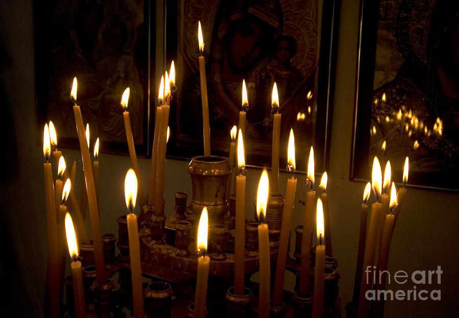 Lit Photograph - lit Candles in church  by Danny Yanai