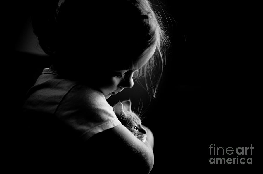 Little child girl hugging kitty by Arletta Cwalina