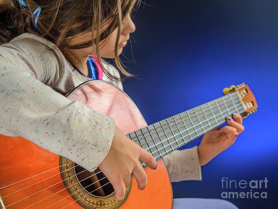 little girl plays guitar photograph by sasha samardzija