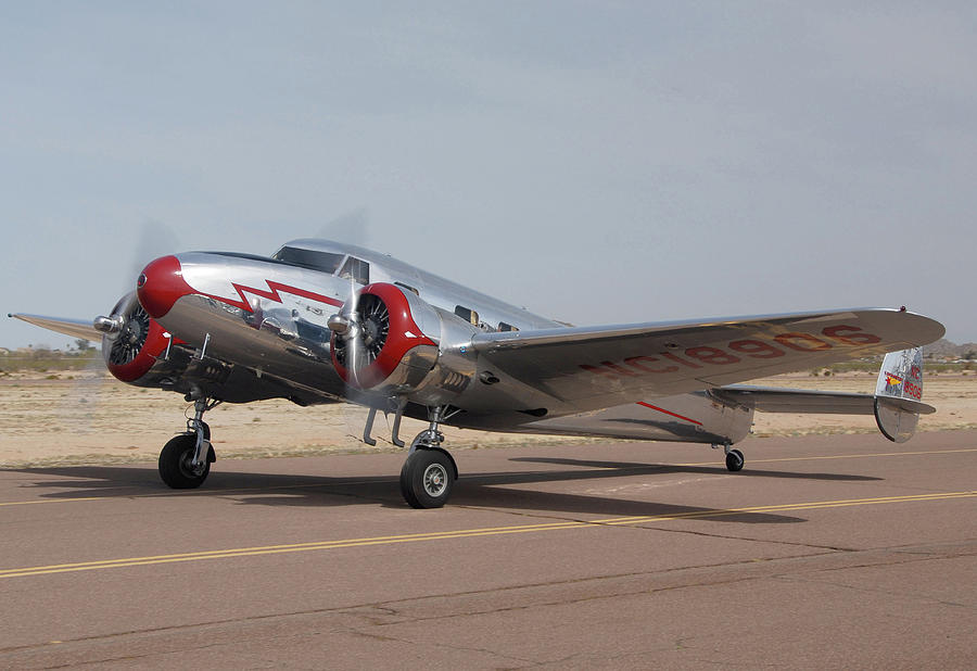 Airplane Photograph - Lockheed 12a Electra Junior Nc18906casa Grande Airport Arizona March 5 2011 by Brian Lockett
