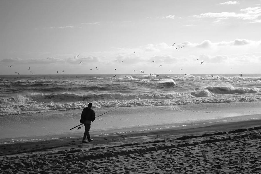 Sea Photograph - Lone Fisherman by Linda C Johnson