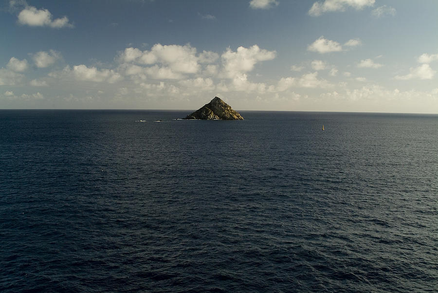 Caribbean Sea Photograph - Lone Rock Island In The Middle Of Vast by Todd Gipstein
