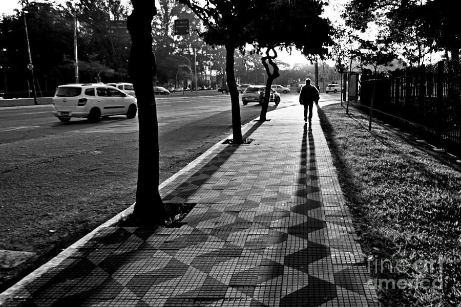 Lonely Man Walking at Dusk in Sao Paulo by Carlos Alkmin