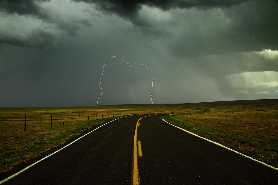 Horizontal Photograph - Long And Winding Road Against Lighting Strike by DaveArnoldPhoto.com