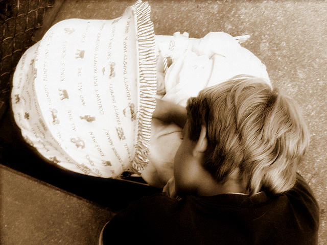 Brothers Photograph - Looking At Baby by Heidi Berkovitz