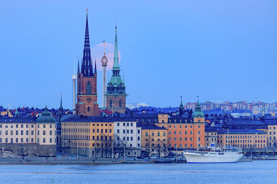 Full Moon Photograph - Lunar teamwork Full moon rising over Gamla Stan in Stockholm by Dejan Kostic